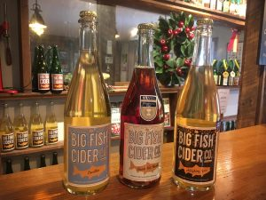 Bottles of Big Fish Cider on the tap room counter