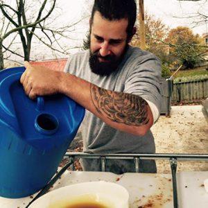 Team Member: Dave pouring pressed cider
