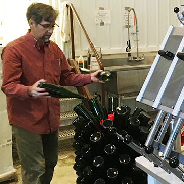 Team Member: David B placing bottles on the drying rack